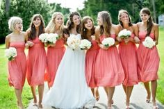 Coral bridesmaid dresses. I like the length of these dresses, too. Thinking long or shin-length dresses.
