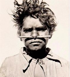 Portrait of an aboriginal boy with a nose piercing from the early Century Image via Webb's.