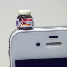 """♥♥ NUTELLA EARPHONE PLUG ♥♥  This is a Super Cute (Kawaii) Nutella ear plug that fits into a 3.5mm headphone jack : iphone 4/4G/3G, HTC, Blackberry, iPad 1/2, other product with 3.5mm headphone jack.  The Measurement: approx. 0.35"""" W x 0.35"""" H   Each ear plug purchased will come in an organ..."""