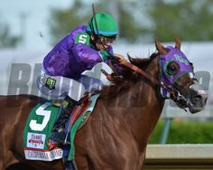California Chrome with Victor Espinoza aboard wins the 2014 Kentucky Derby Courtney V. Bearse Photo