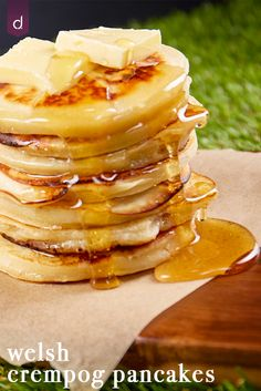 Welsh crempog pancake dripping with golden honey and topped with a lump of butter.