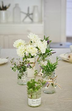 Love the ribbon. country flowers, herbs table decor