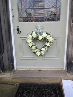 Heart wreath of gyp, white avalanche and spray roses.
