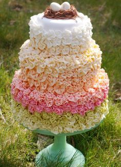 Multicolored Tiered Pastel Ruffle Cake Topped with Birds Nest