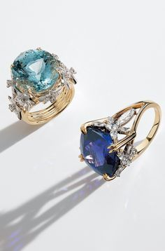 Tiffany & Co. Schlumberger® rings in platinum and 18k gold with an aquamarine and a tanazanite and diamonds.