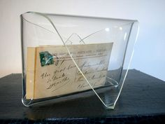 """Simple staging from the """"head on"""" POV. A note written on antique paper, with an old stamp need not be staged among many things, but can be showcased nicely in a lucite envelope. Where to purchase one of those..."""