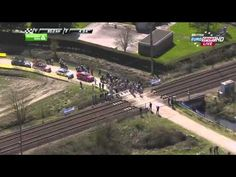 Pack of cyclists nearly hit by high-speed train during race in France