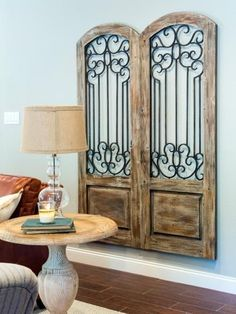 While they likely won't be a perfect fit for your front entrance, vintage doors can also be used as a decorative wall hanging like Joanna did here. Old screen doors are a popular thrift store find that can be used as decor or even transformed as a useful spot to hang jewelry, cooking utensils or whatever your heart desires. Old Screen Doors, Old Doors, Front Doors, Style At Home, Vintage Home Decor, Diy Home Decor, Art Decor, Vintage Diy, French Vintage
