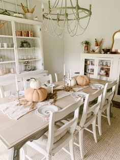 Simple Thanksgiving Tablescape | Sarah Jane Interiors Hosting Thanksgiving, Thanksgiving Table Settings, Thanksgiving Tablescapes, Farmhouse Area Rugs, Vintage Market Days, White Dishes, Painted Leaves, Farmhouse Lighting, Dining Table In Kitchen