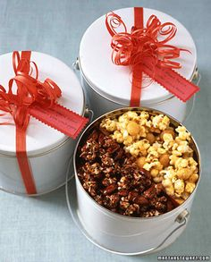 Pack two kinds of homemade flavored popcorn in one bucket tin.