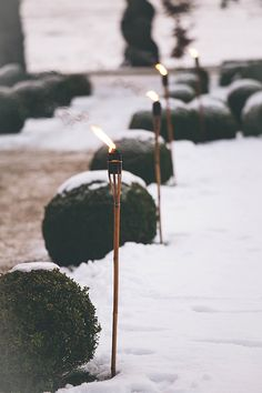 Torches lit to show you the way, out of the cold and into the warm.  Images by Emma Cleveley