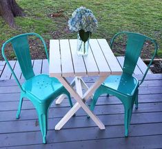 White Bistro table made from 2x4 wood with blue chairs