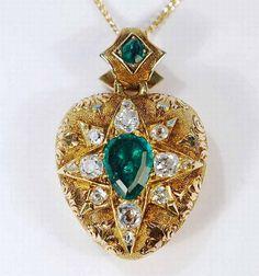 A Victorian emerald and diamond locket pendant