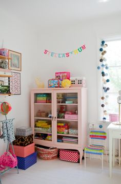 Love this storage unit for toys, could add curtains as well inside to hide things if you wanted
