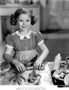 cute vintage photo of Shirley Temple making cookies