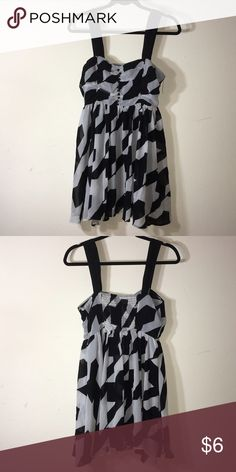 Black and grey patterned dress Cute dress, has some loose stitching on the inside that should be able to be sewed back together. Dresses