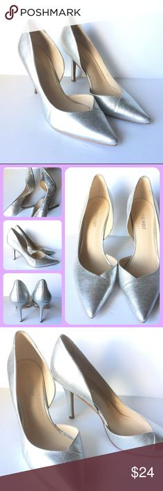 Nine West Jowzer Silver Metallic Leather Heels 8 Beautiful metallic silver leather heels by Nine West. Can be paired with slacks for work, or a night out! Very versatile Heel! Great quality, light wear. Size 8 Nine West Shoes Heels