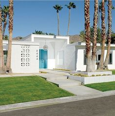 Palm Springs Clean Mid Century Modern Exterior With Aqua Door, Breezeway blocks, white paint, palm trees