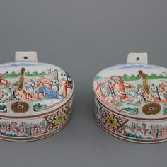 A pair of very fine Dutch Delft petit feu butter tubs with biblical scenes, early 18th C.