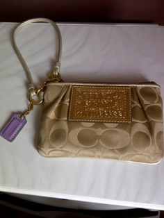 Available @ trendtrunk.com Coach-Poppy-Signature-Wristlet-42885-6-x4-. By Coach. Only $30.00!