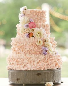 100 Wedding Cakes that WOW | Holy ruffles! The good thing about ruffles is they are extremely cute and its that much more frosting to indulge in! See more of these steal worthy Vintage Reception Ideas here captured by Sunny 16 Photos with cake by Walton's Fancy and Staple.