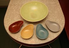 I have all these pieces.  I never thought about putting them together like this.  Actually, I have enough comma dishes to go completely around the bowl.  :)