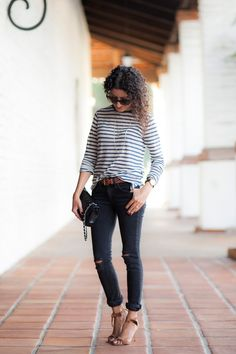 Use a belt to tie outfit together. Belt and shoes tan. Pants and purse black. Shirt a different neutral navy.