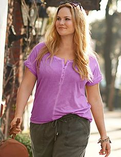 The Summer classic Henley comes to life in sun-washed hues for that lived-in and well-loved look. Partial button front makes it versatile for wearing alone or layered, with rolled short sleeves and a dainty chest pocket for a fun finish. lanebryant.com