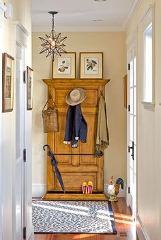 In this entry designed by architects Siemasko and Verbridge, a vintage door is repurposed as a backing for coat hooks; a length of pipe cleverly corrals umbrellas. Crown molding trims out the top and bottom, where it forms a tray. Find similar doors on Craigslist for about $100.