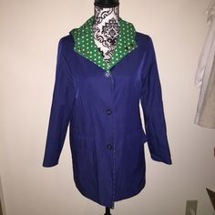 Blue / green white polka dot reversible rain coat Blue / green and white polka dot reversible rain coat. Great condition. Jackets & Coats Trench Coats