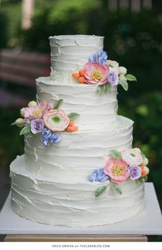 10 stunning floral cakes for spring, featuring sugar flowers, buttercream flowers, painted flowers and more. Spring wedding cake inspiration on TheCakeBlog.com.