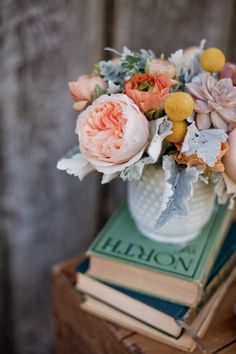 peach, yellow and gray #centerpiece - photo by Retrospect Images - view more: http://ruffledblog.com/winery-chic-inspiration/