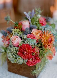 """Wildflowers will go in mason jars: For """"Welcome Party"""" the mason jars will be dipped in glitter for """"After Party"""" the flowers will be sprinkled with glitter."""