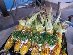 "Minnesota Meredith's corn on the cob!  Grill the cobs in their husks; shucks, oops, shuck the grilled cobs then roll each in a ""customized"" mixture of minced garlic, chili powder(s), black pepper, and sea salt.  Stack the seasoned cobs on a platter, drizzle on fresh lime juice and sprinkle with grated Cotija cheese.  Mix together chopped cilantro, chives and/or green onions and embellish the beauties."
