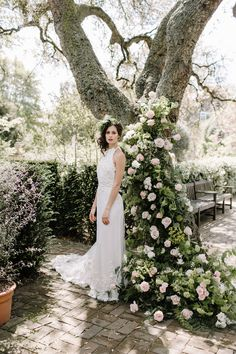 ramblimg roses on tree with bride Always Andri Wedding Planner   Designer Beccy Goddard Photography Chelsea Physic Garden Photoshoot