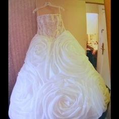 """Designer Wedding Gown, worn once Designer wedding gown. Only worn once. White on white gown. Ball gown, strapless. Hoop bottom which is great because it makes the gown a ball gown and gives the elegance but is not weighed down by layers and so you are not hot and can move and dance freely. Cost over $5,500 originally. I am 5'3.5"""" and wore 4-5 inch heels and the length was perfect. It looks amazing in pictures. Everyone said that they never saw a dress like it. So beautiful. Dresses"""