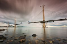 https://flic.kr/p/KMGM1Q | Reaching out | Given the unfinished state of the new brand Forth Road bridge there was no way I was going pass an opportunity up to shoot this as once it's finished you cannot repeat this shot, another bout of rainstorms had appeared and one can be seen on the far shoreline at Dalmeny touching down, a break on the North Queensferry side allowed for this to be taken before it poured down yet again for the umpteenth time so I was really lucky to be able to get this…