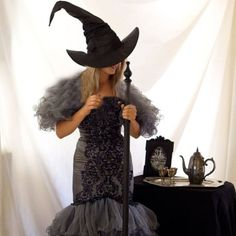 DIY Wicked Witch Costume made from a thrift store wedding dress. Use some dye to transform a wedding dress to witch costume!