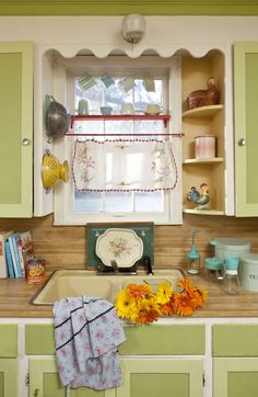 vintage kitchen style...love the shelves. The house I grew up in had those curved shelves in both sides of the window!