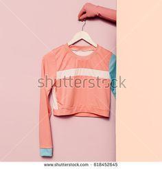 Stylish sportswear. Minimal fashion. Top stripe print on a hanger. Wardrobe trends