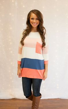 The Pink Lily Boutique - Coral Colorblock Tunic, $36.00 (http://thepinklilyboutique.com/coral-colorblock-tunic/)