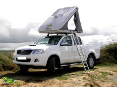 Here's a photo from our photoshoot down at Crow point, Braunton Burrows on Thursday 29th August 2013. This is our Toyota Hilux with a James Baroud Discovery Evolution Roof Top Tent mounted on via roof bars. James Baroud Roof Top Tents are now available to HIRE from us at DEVON 4x4! For more information visit... http://www.devon4x4.com/index.php?option=com_k2=item=877:james-baroud-tents-to-hire-from-devon-4x4=5