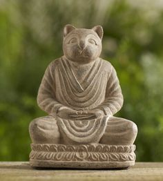 """Equal parts calming and charming, this delightful ode to felines is an invitation to sit, pause and reflect on the beauty of the great outdoors. Crafted in Indonesia from crushed basalt. 4.5""""D x 6""""W x 8""""H"""