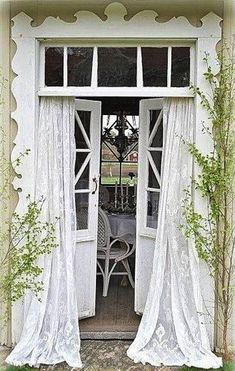 Wow...what a DREAM! I would love love love to have such beautiful doors and curtains to frame a lovely patio!