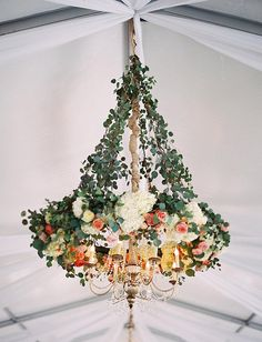 Lighting disguised as a floral arrangement or a floral arrangement disguised as lighting? I don't know but I love it.