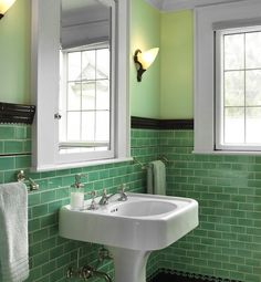 tiny bathrooms that are big on style...Vintage Chic    Classic vintage style transforms this tiny bathroom. The color of the tile, along with the black and white tile accents, gives it a fun apothecary appeal.