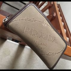 Authentic Prada Milano DAL 1913 wallet  Authentic Prada Milano DAL 1913 wallet.  Excellent condition!  Used a couple of times.  Has certificate of authenticity.  Made in Italy Prada Bags Wallets