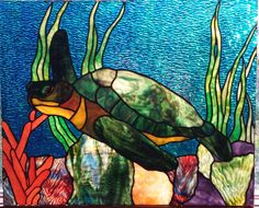 Custom stained glass window by Michelle Carlson, www.rockledgeglassdesign.com, featuring Uroboros glass