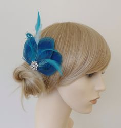 Turquoise Blue Peacock Feather Hair Clip Crystal Fascinator Wedding Bridal Bridesmaid Hair Accessory 'Lizbeth''. £15.99, via Etsy.