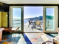 Calm Waters rental in Otis - lakefront with deck and dock. Avail preferred dates